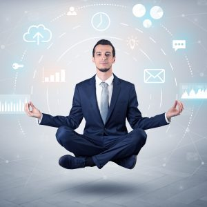 Elegant calm businessman levitates in yoga position with data circulation concept